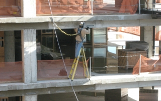 Worker on building with safety harness & lifeline
